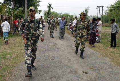 Indian security personnel patrol the attack-hit area of the Balapara village in the northeastern Indian state of Assam May 2, 2014. CREDIT: REUTERS/STRINGER